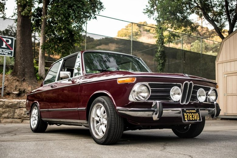 A Childhood Spent In The Backseat Of Bimmers Led To This Malaga Red BMW 2002