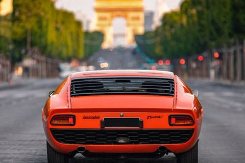 A Lamborghini Miura out and about on the empty streets of Paris