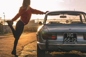 A morning stretch with Andra and an alluring Alfa Romeo GTV