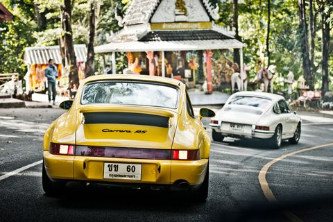 On the curves of Thailand's Tuscany with a wild pack of Porsche 911s