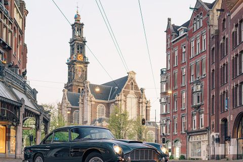 Two classic Aston Martins on the deserted streets of Amsterdam